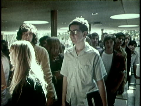 1973 zo teenage boy adjusting glasses and standing in line with other students, vo talking about being academically inclined / united states - geek stock videos & royalty-free footage