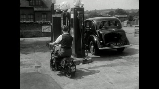 teenage boy arrives at fuel station on scooter; 1950 - fossil fuel stock videos & royalty-free footage