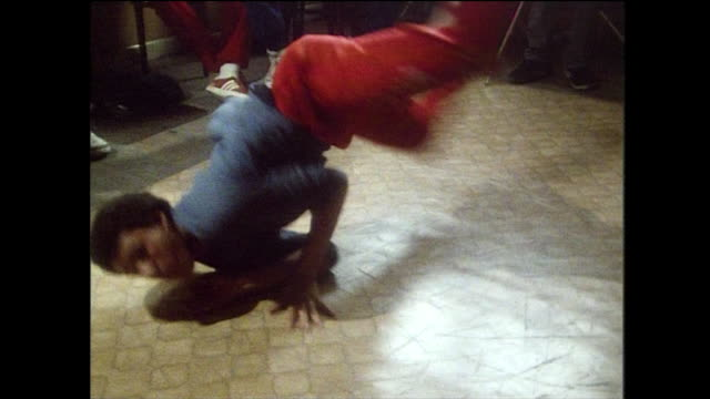 teenage boy breakdances on linoleum floor; 1984 - bbc archive stock-videos und b-roll-filmmaterial