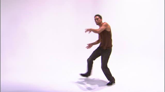 ws zi teenage boy (14-15) breakdancing, against white background / orem, utah, usa - only teenage boys stock videos & royalty-free footage