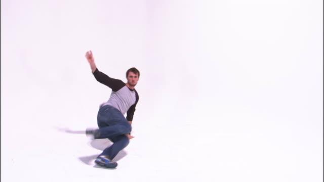 ws teenage boy (14-15) breakdancing, against white background / orem, utah, usa - only teenage boys stock videos & royalty-free footage