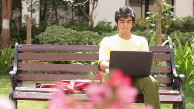 teenage boy chatting on a laptop - one teenage boy only stock videos & royalty-free footage