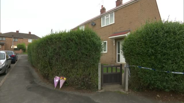 teenage boy dies in docaster shed fire england south yorkshire doncaster ext police car parked alongside residential back garden forensic officers in... - south yorkshire stock videos and b-roll footage
