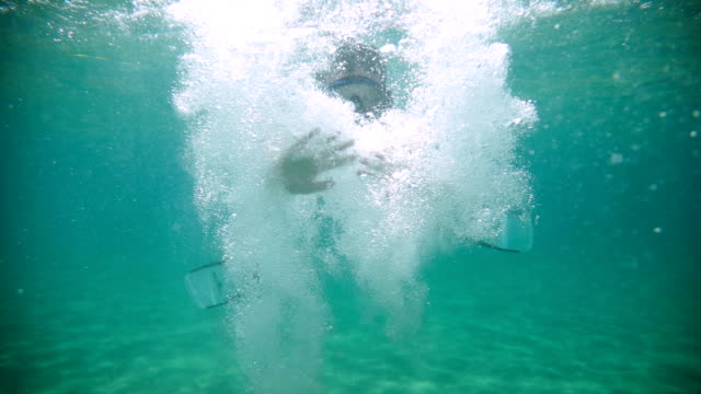 teenage boy diving in the ocean.halo greeting - boys stock videos & royalty-free footage