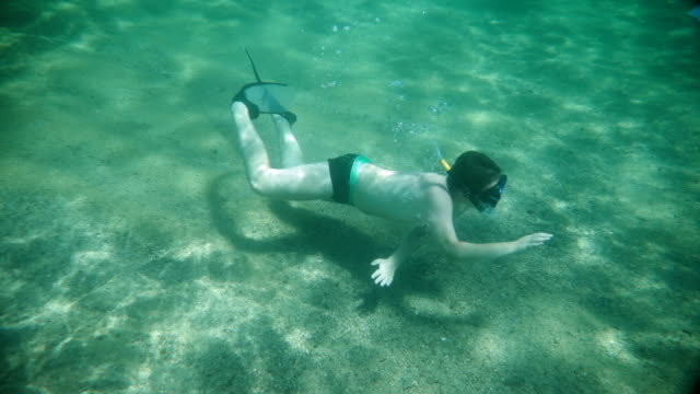 teenage boy diving in the ocean.problem with diving flipper - diving flipper stock videos & royalty-free footage