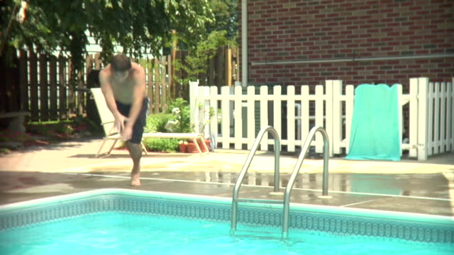 MS, Teenage boy (16-17) diving into swimming pool, Middlesex, New Jersey, USA