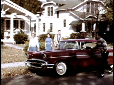 / teenage boy drives his 1957 chevrolet bel air hard top over to his girlfriend's house and meets his friends there / teens gather around car /... - chevrolet stock videos & royalty-free footage