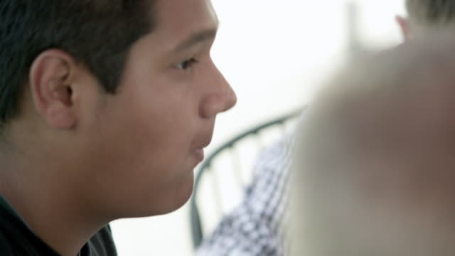 teenage boy eating and nodding. - human head stock videos & royalty-free footage