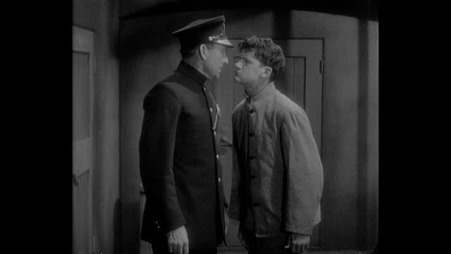 1932 a teenage boy has a breakdown after his friend falls ill - 産みの苦しみ点の映像素材/bロール
