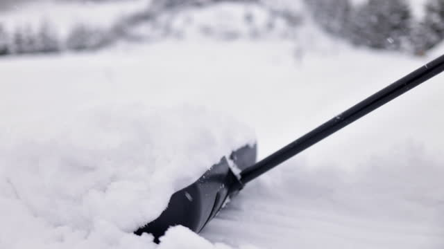 teenage boy helping to remove snow from the backyard - spade stock videos & royalty-free footage