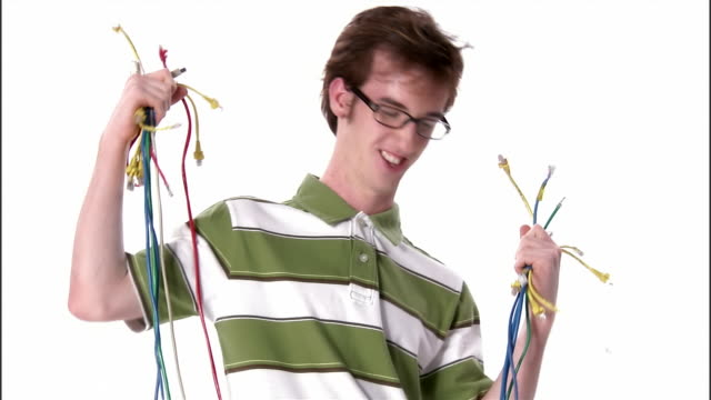 ms, teenage boy holding bunch of computer cables, portrait, studio shot - one teenage boy only stock videos & royalty-free footage
