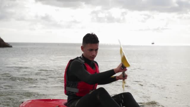 teenage boy kayaking - hobbies stock videos & royalty-free footage