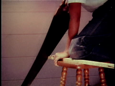 ms teenage boy kneeling on piece of wood and sawing it / usa - one teenage boy only stock videos & royalty-free footage