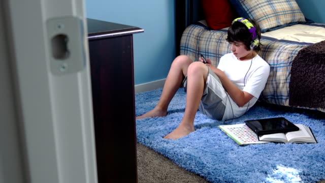 teenage boy listens to music - rug stock videos & royalty-free footage