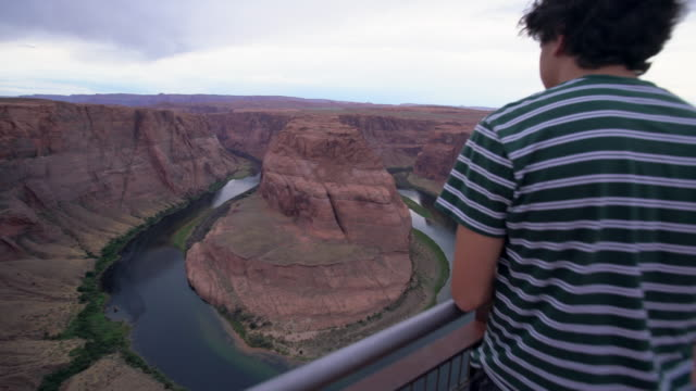 ws teenage boy looking at horseshoe bend in page, arizona - eternity stock videos & royalty-free footage