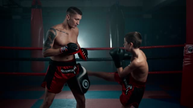 teenage boy on a boxing training - two people stock videos & royalty-free footage