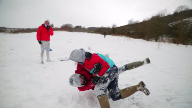 Teenage Boy Play Fighting in the Snow