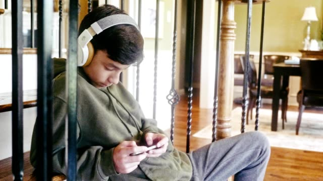 teenage boy plays game on smartphone - adolescence stock videos & royalty-free footage