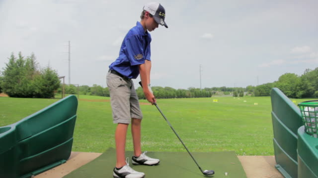 ms teenage boy practicing throwing golf ball / leesburg, virginia, united states - golf club stock videos and b-roll footage