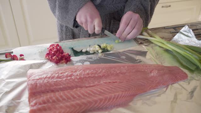 a teenage boy preparing a filet of salmon - one teenage boy only stock videos & royalty-free footage