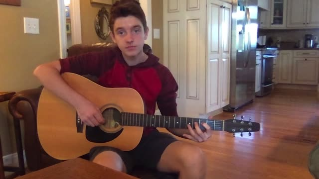 teenage boy records himself as he practices playing the acoustic guitar - one teenage boy only stock videos & royalty-free footage