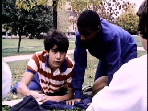 1986 montage teenage boy refusing smoking marijuana in park, usa, audio - rebellion stock videos & royalty-free footage