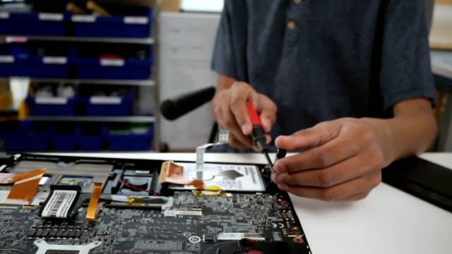 teenage boy repairs laptop hard drive - mother board stock videos & royalty-free footage