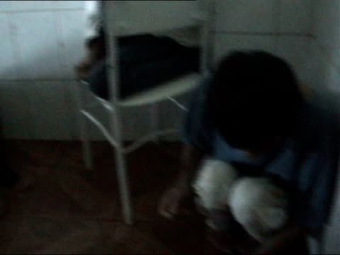 Teenage boy rescued from Romanian orphanage as a child visits his country Orphanage scenes ROMANIA INT Boy in orphanage repeatedly rocking his head...