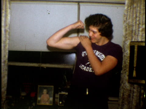 1973 ms teenage boy showing his muscles to camera / bronx, new york - teenage boys stock videos & royalty-free footage