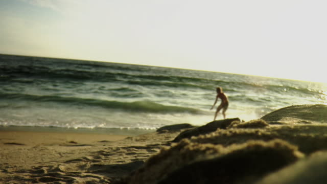 ws teenage boy (14-15) skim boarding on beach / laguna beach, california, usa - skimboard stock videos and b-roll footage