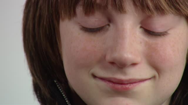 ecu zo teenage boy smiling and playing handheld video game / new york, usa - handheld video game stock videos & royalty-free footage