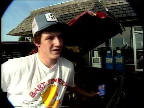 teenage boy talking about going to the city of monett on saturday nights - baseballmütze stock-videos und b-roll-filmmaterial
