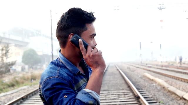 teenage boy talking on mobile phone - teenage boys stock videos & royalty-free footage