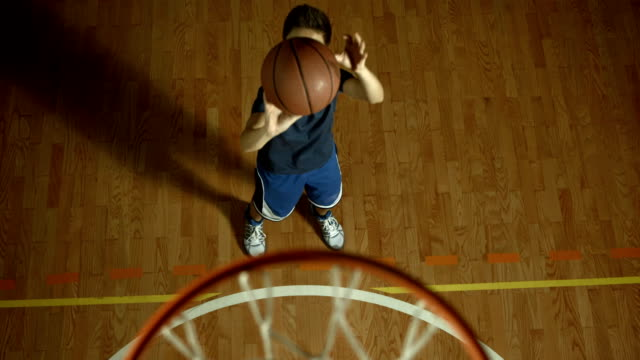 hd slow motion: teenage boy throwing a basketball - teenage boys stock videos & royalty-free footage