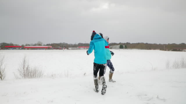Teenage Boy Throwing a Snowball