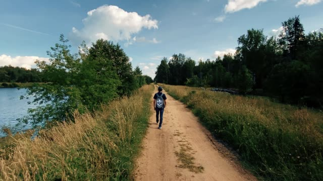 teenage boy walking alone in the forest - rucksack stock videos & royalty-free footage