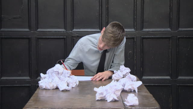 teenage boy writing, getting frustrated and crumpling paper - only teenage boys stock videos & royalty-free footage