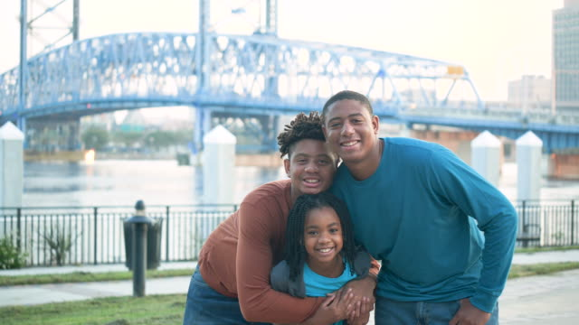 teenage boys and their little sister at city waterfront - 14 15 years stock videos & royalty-free footage