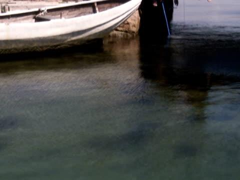 Teenage boys fishing crab Bohuslan Sweden.
