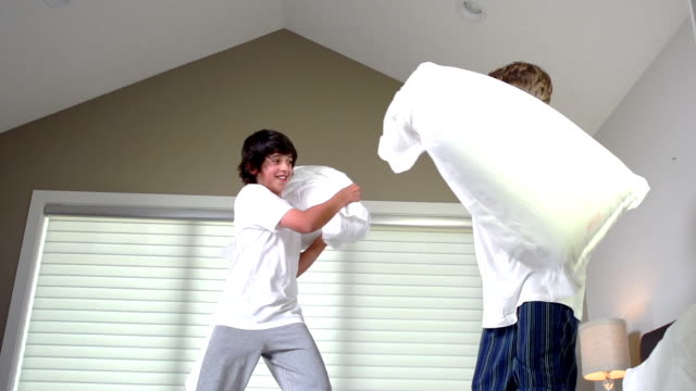 Teenage Boys Having Pillow Fight