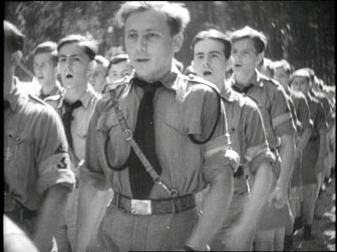 teenage boys in hitler's youth army march and sing songs in harmony - adolf hitler stock-videos und b-roll-filmmaterial