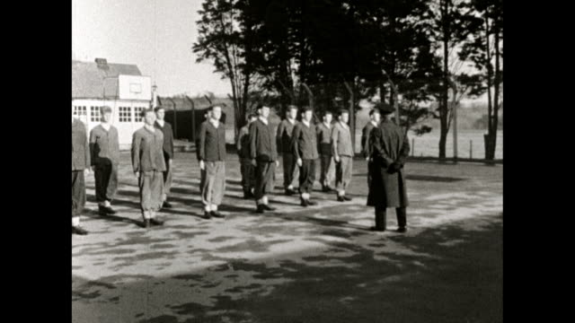 teenage boys march outdoors in a borstal school; 1958 - cadet stock videos & royalty-free footage