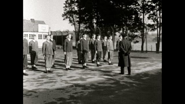 teenage boys march outdoors in a borstal school; 1958 - prisoner stock videos & royalty-free footage