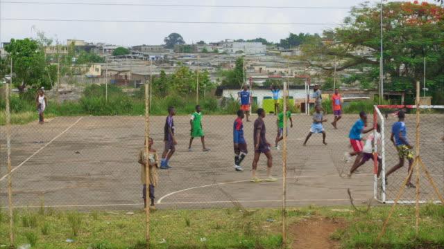 teenage boys play football, ivory coast - côte d'ivoire stock videos & royalty-free footage