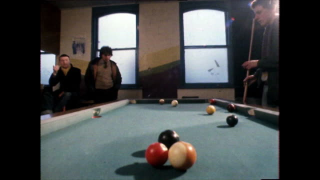teenage boys play pool together in a youth club; 1980 - pool cue sport stock videos & royalty-free footage
