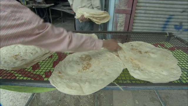ms teenage boys putting dough on cooling rack, iran - iran stock videos & royalty-free footage