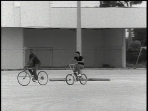 teenage boys riding bikes and doing wheelies in florida - bmx cycling stock videos and b-roll footage