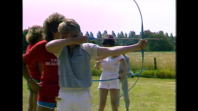 teenage boys shoot bows and arrows at target; 1984 - 1984 stock videos & royalty-free footage
