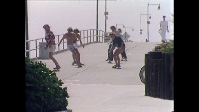 teenage boys skateboard along promenade in san francisco - bbc archive stock-videos und b-roll-filmmaterial