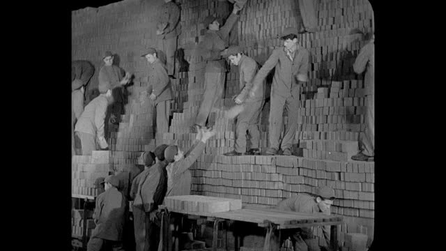 1932 teenage boys stack bricks in work camp (juvenile prison) - unemployment stock videos and b-roll footage